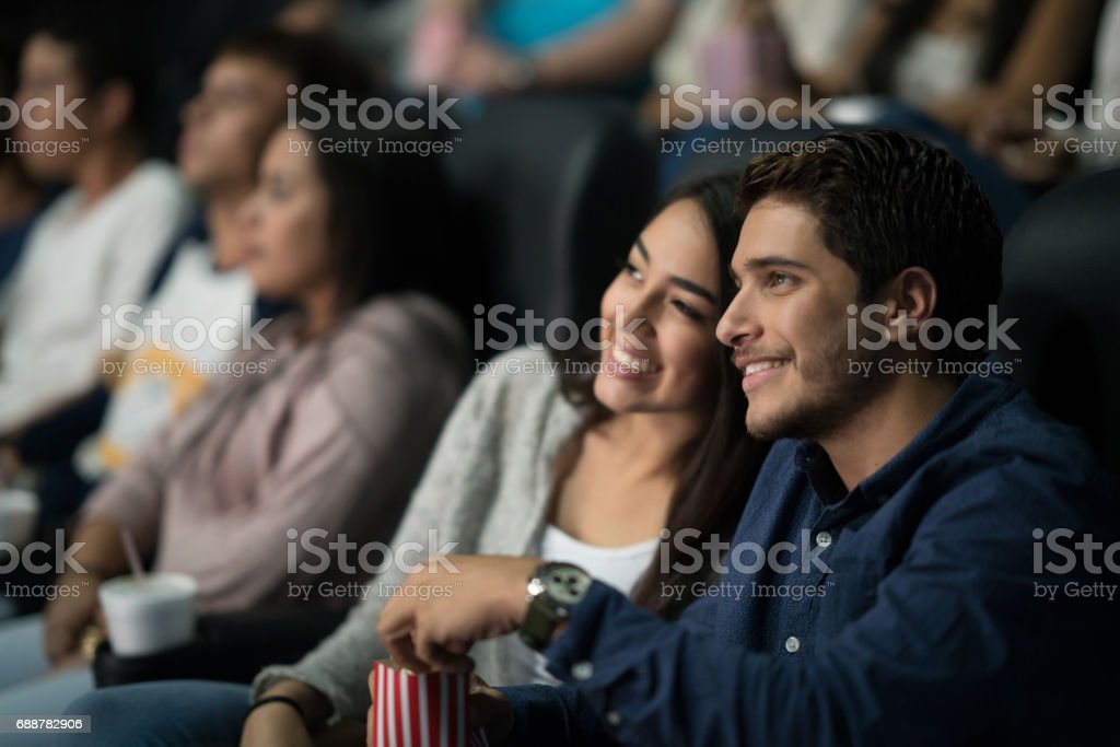 Couple watching a movie at the cinema stock photo