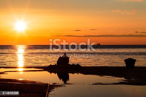 istock couple watching a romantic sunset 514846398