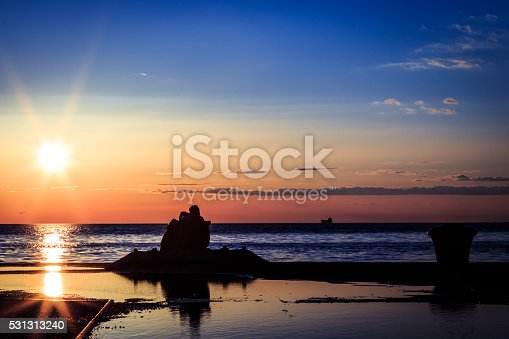 istock couple watching a romantic sunset 531313240