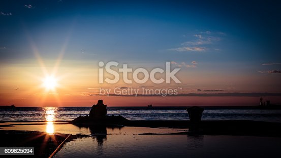 istock couple watching a romantic sunset 609825094