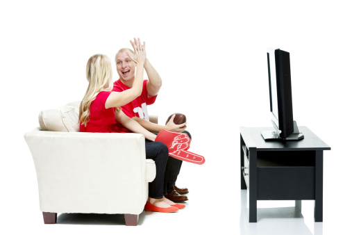 Couple watching american football game and cheeringhttp://www.twodozendesign.info/i/1.png