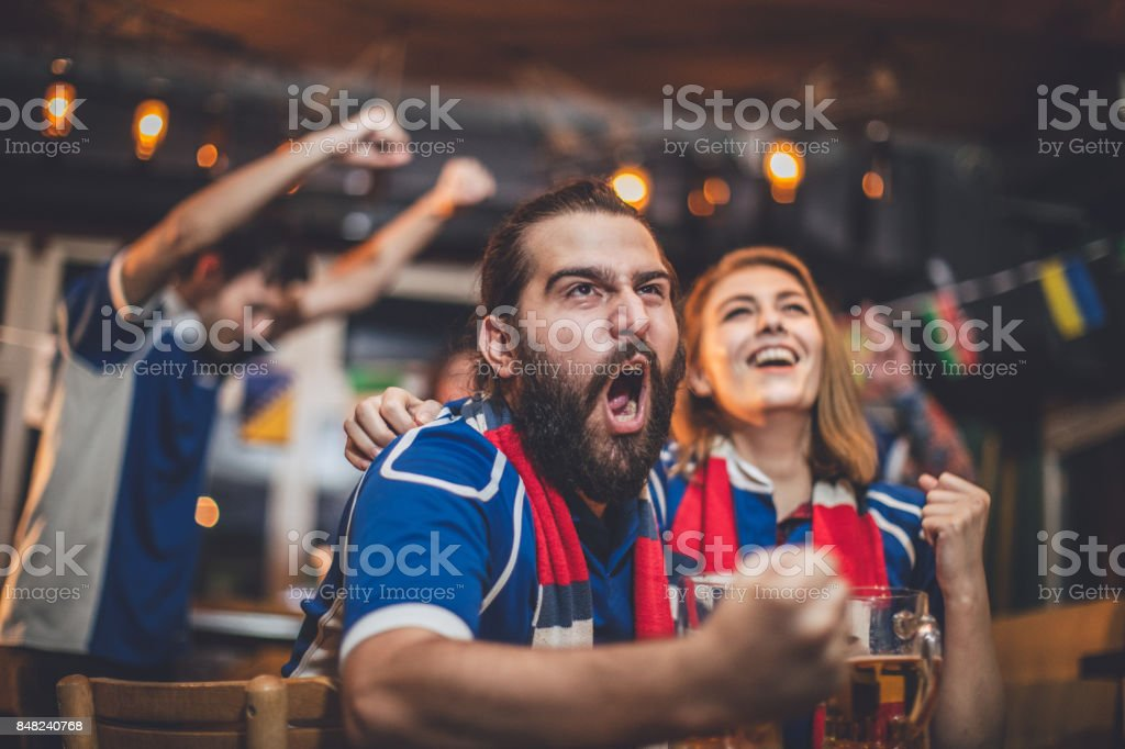Couple watching game in pub stock photo
