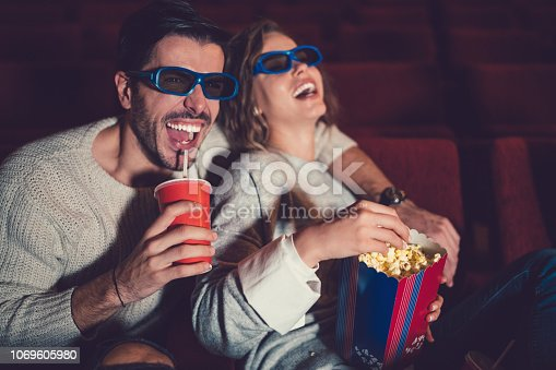 187095683 istock photo Couple watching movie in the cinema 1069605980