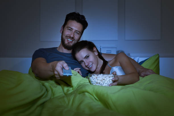 Couple watching movies stock photo
