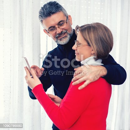 Mature couple using phone