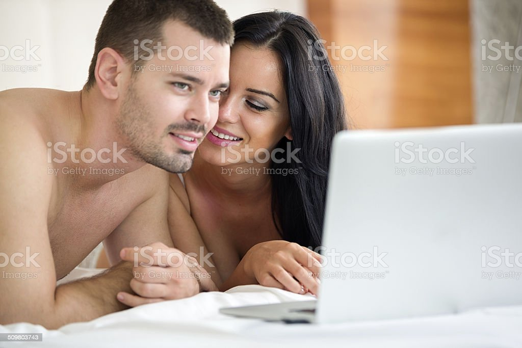 Couple watching porn movie stock photo