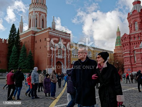 Moscow, Russia - February 24, 2020: a senior couple is watching Red Square
