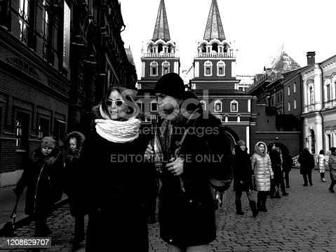Moscow, Russia - February 24, 2020: a mid adult couple is watching Red Square