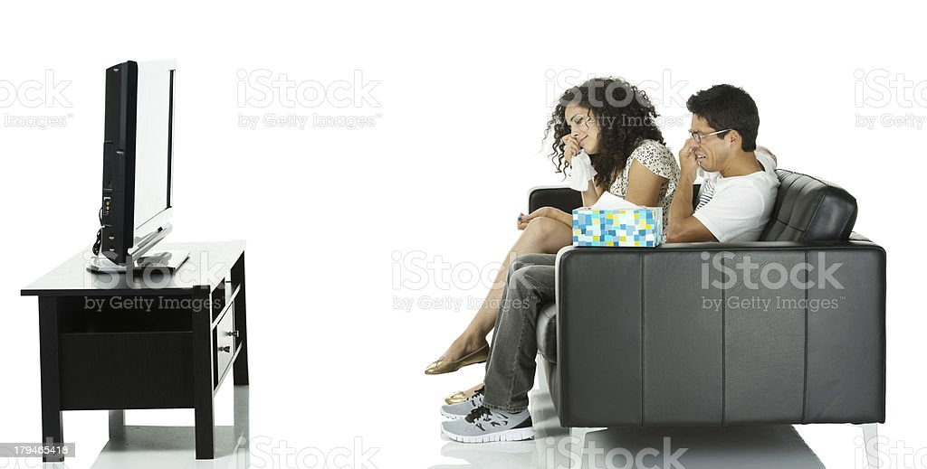 Couple watching sad movie on tv and crying royalty-free stock photo