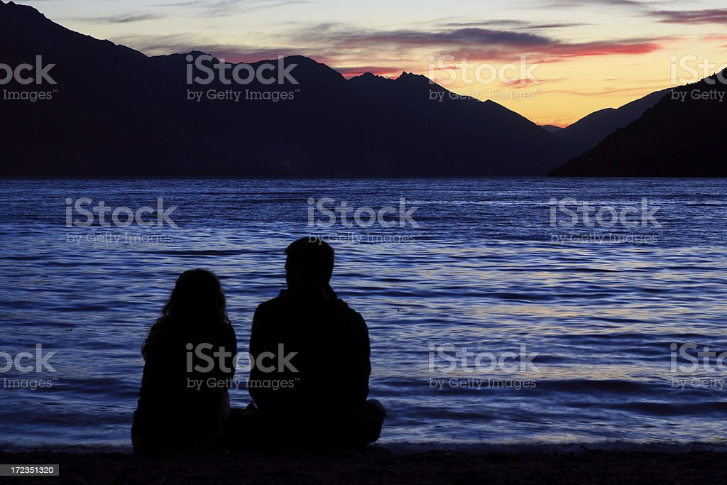 Couple Watching Sunset Over the Lake royalty-free stock photo