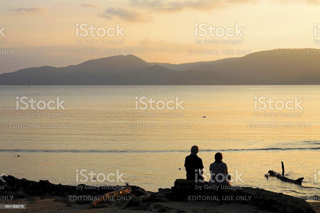Couple watching sunset sunset point port blair india stock photo