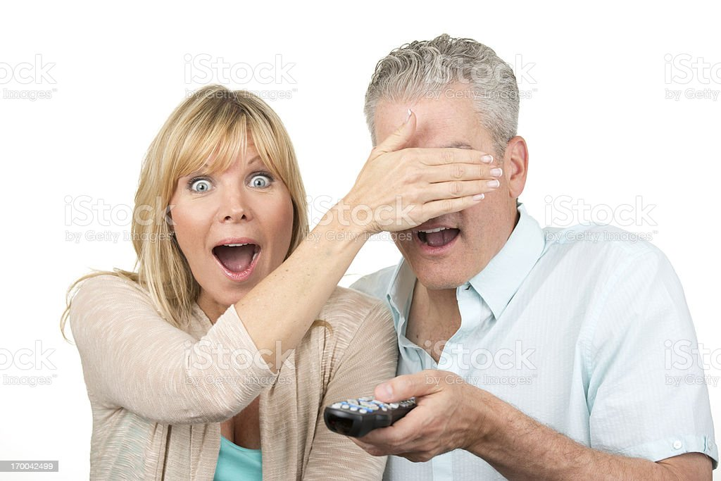 couple watching televison stock photo