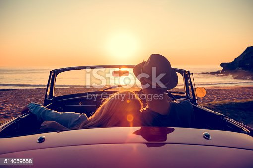 istock Couple watching the sunset in a convertible car. 514059558