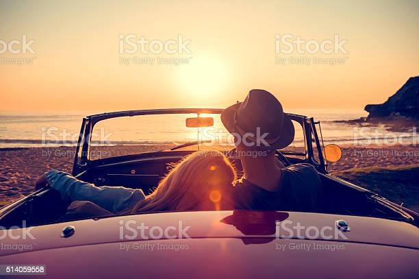 Couple watching the sunset in a convertible car picture id514059558?b=1&k=6&m=514059558&s=612x612&h=gtvb f5axeqdpy8zhiqvhtf2n4daqpn5km13z0g2x9m=