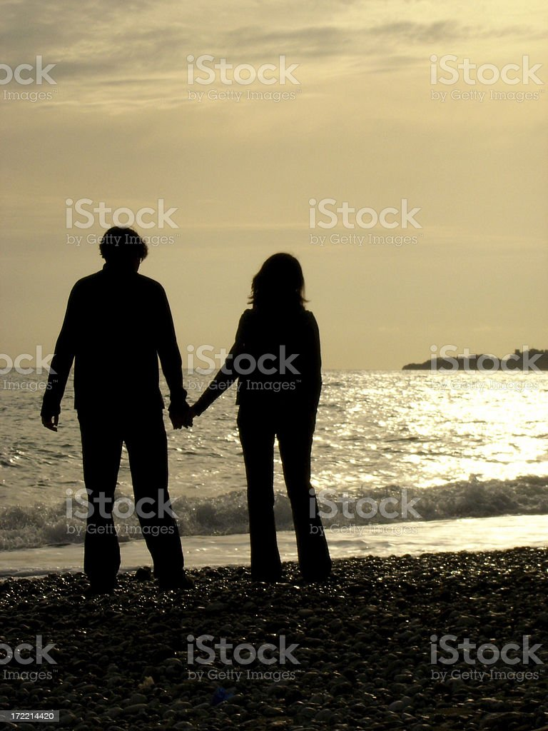 couple watching the sunset royalty-free stock photo