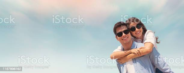 Couple wear sunglasses having fun on blue sky and the beach picture id1157896162?b=1&k=6&m=1157896162&s=612x612&h=ycqkunxh6b9uqjeq5yrjmopbtpqvcm8v2qcpva ta s=