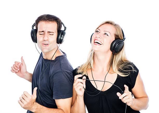 Couple Wearing Headphones Dancing stock photo