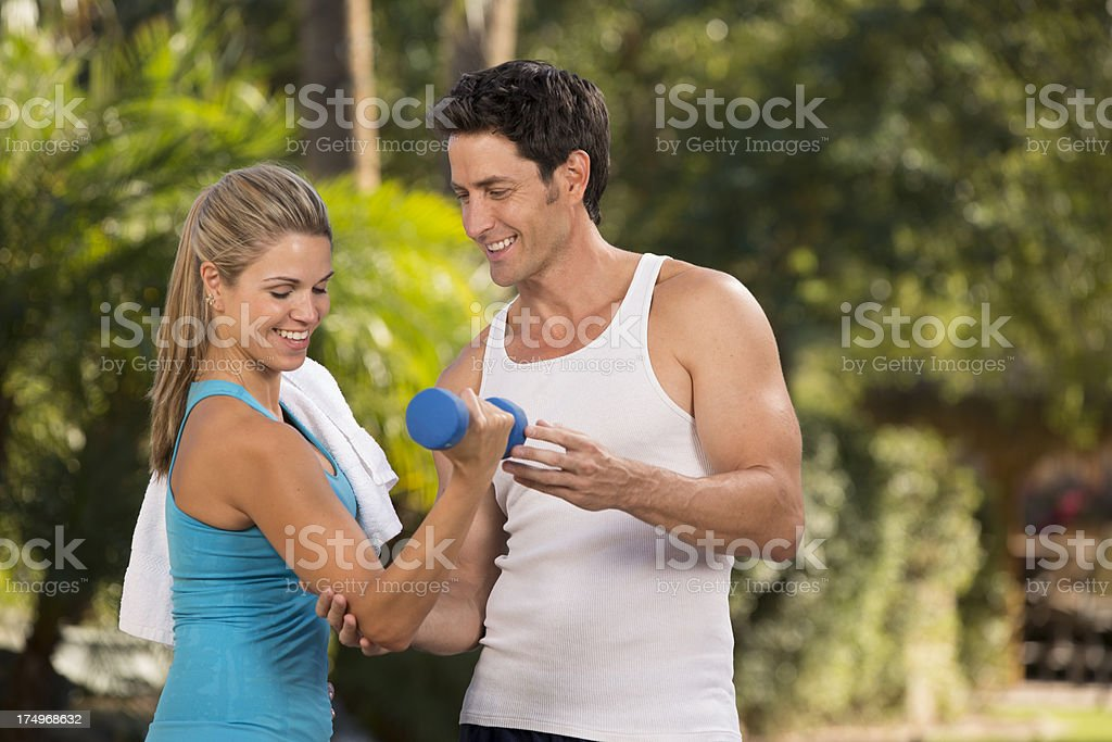 Couple weight training outside royalty-free stock photo