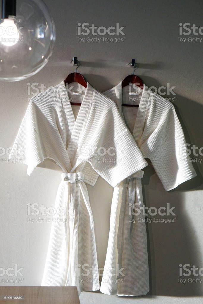 Couple White bathrobe in wooden wardrobe - foto stock