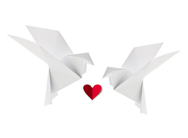 Couple white loving dove of origami with red heart stock photo
