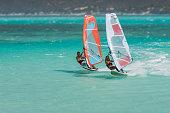 Couple windsurfers in the lagoon of Emerald Sea, Antsiranana bay (Diego Suarez), Madagascar.
