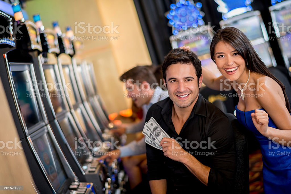 Couple winning at the casino stock photo