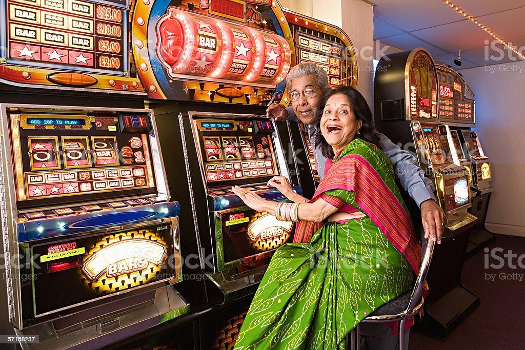 Couple winning on fruit machines stock photo