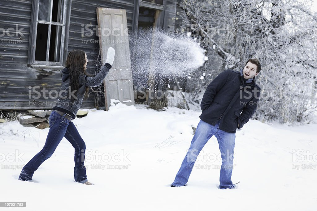 Couple winter snowball fight royalty-free stock photo