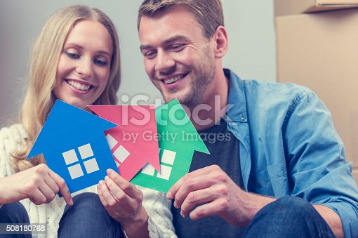 istock Couple with 3 house symbols. choice concept. 508180768