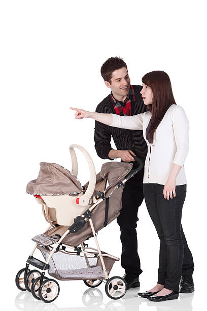 Couple with a baby walker stock photo