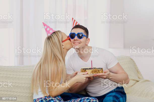 Couple with a cake with candles congratulates on his birthday on picture id937715154?b=1&k=6&m=937715154&s=612x612&h=wl zuf5sxuffwgoxx5l8gtqu9jf6thbfkggykqc9vti=