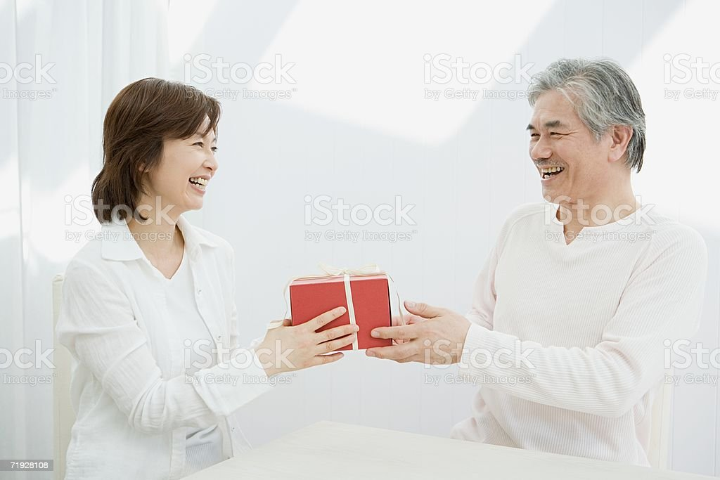 Couple with a gift royalty-free stock photo