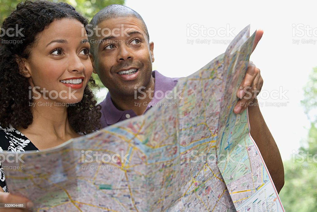 Couple with a map Couple with a map 2015 Stock Photo