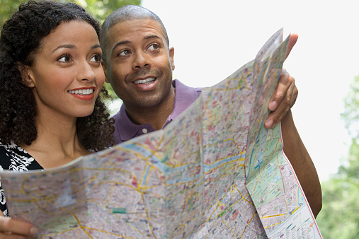 Couple With A Map Stock Photo - Download Image Now