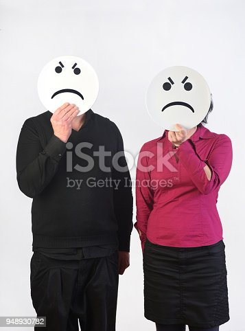 couple with a plate in their face who are angry