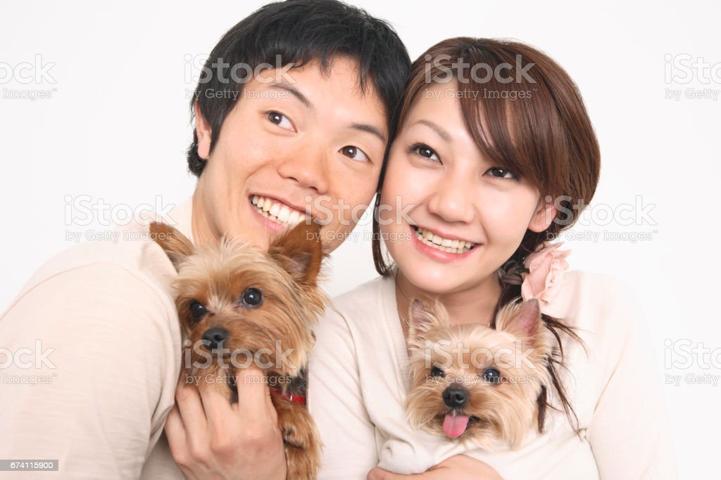 A couple with a puppy royalty-free stock photo