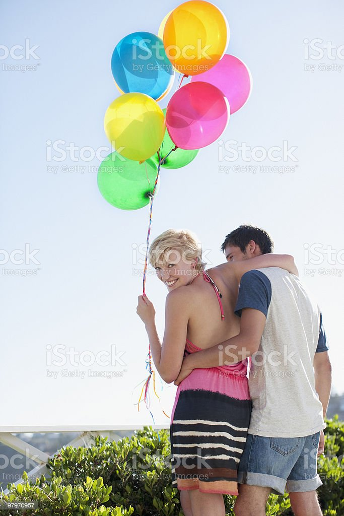 Couple with balloons hugging royalty-free stock photo