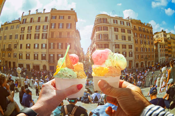 Couple with beautiful bright  sweet Italian ice-cream with different flavors  in the hands stock photo