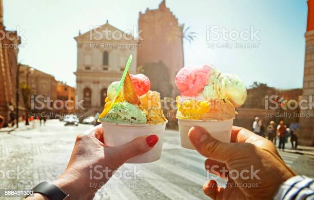 Photo of Couple with beautiful bright  sweet Italian ice-cream with different flavors  in the hands