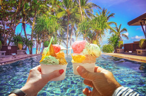 couple with beautiful bright  sweet italian ice-cream with different flavors  in the hands - vacations food stock pictures, royalty-free photos & images