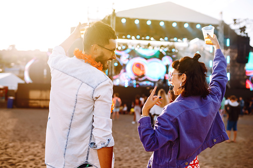 Couple with beer at music festival. Summer Beach party, holiday, vacation concept.