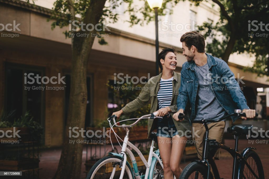 Couple with bicycles on the street stock photo