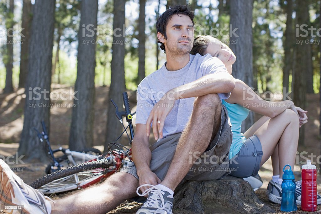Couple with bicycles relaxing in forest royalty-free stock photo