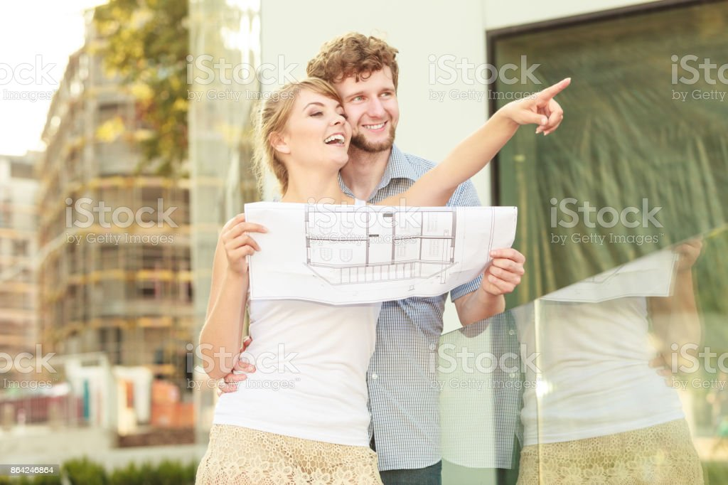 couple with blueprint project outdoor royalty-free stock photo