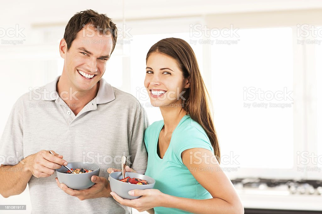 Couple With Bowls Of Fruit Salad royalty-free stock photo