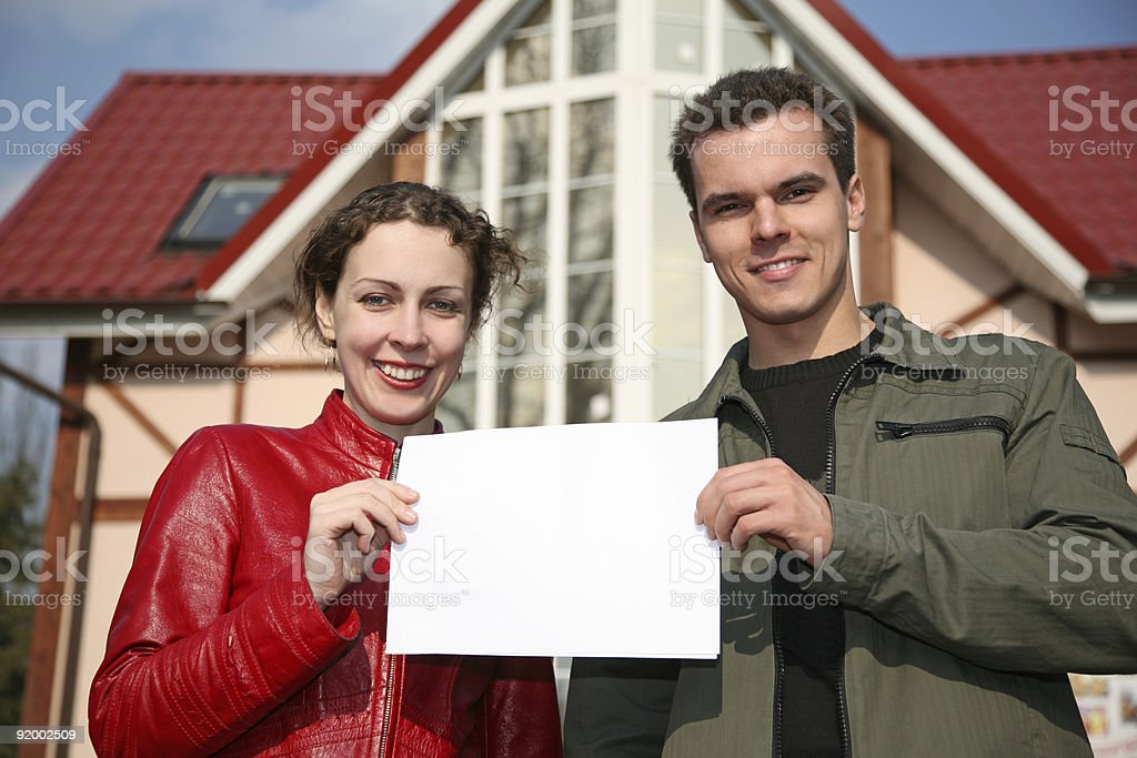 couple with card and house royalty-free stock photo