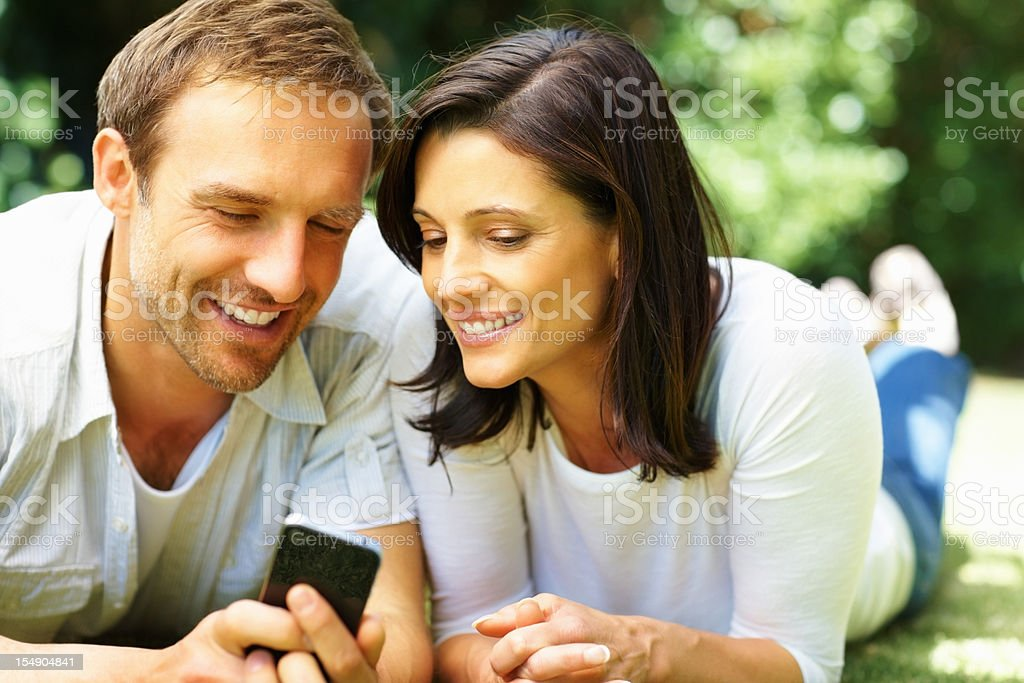 Couple with cell phone royalty-free stock photo