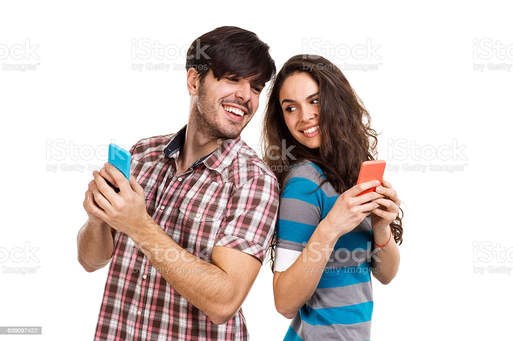 Couple with cell phones stock photo