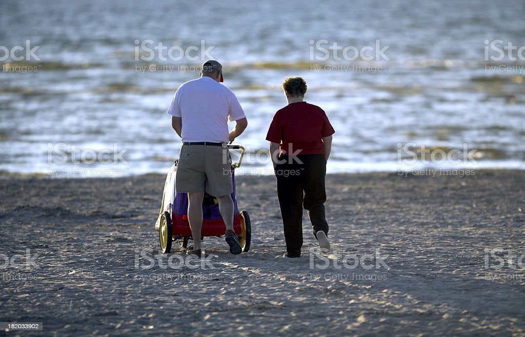 couple with child on beach royalty-free stock photo