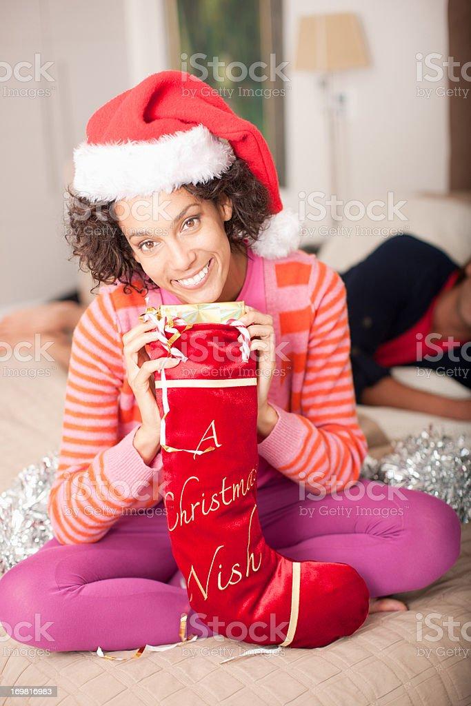 Couple with Christmas stocking on bed stok fotoğrafı
